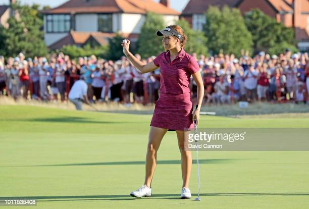 Georgia Hall of England acknowledges the crowds after holing the winning putt on the 18th hole during the final round of the Ricoh Women's British...