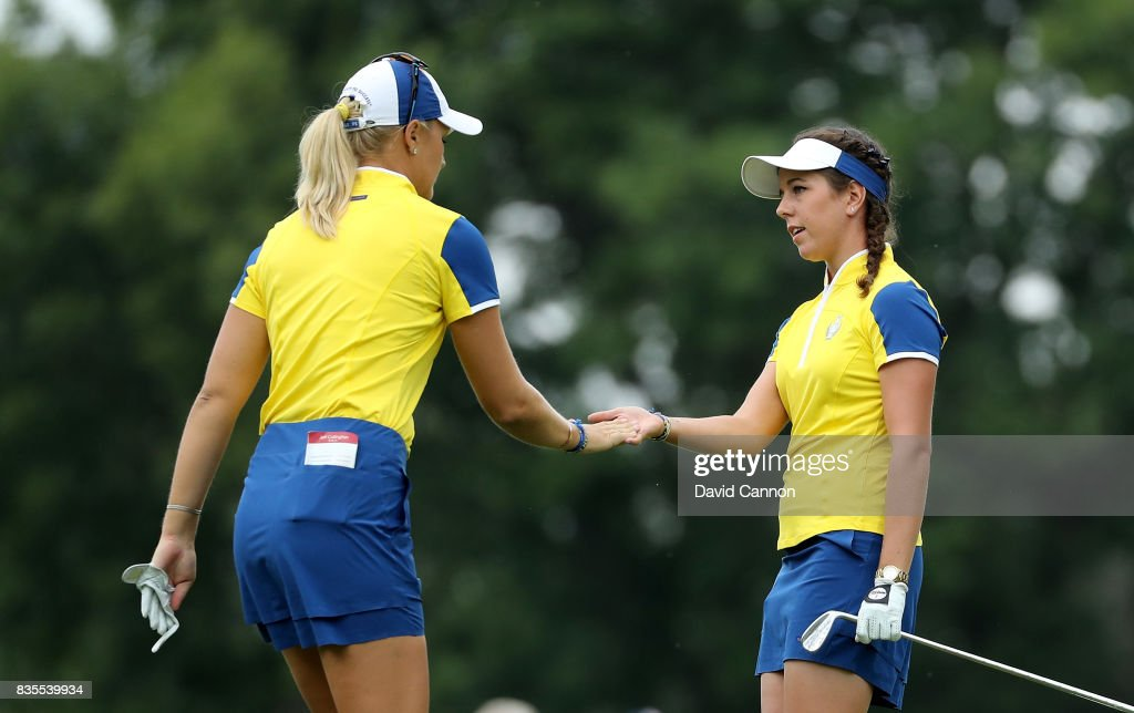 Georgia Hall of England (R) and Anna Nordqvist of Sweden and the European Team celebrate on the 16th hole after Hall had holed a crucial putt in their match against Stacy Lewis and Gerina Piller of the United States Team during the morning fousomes matches in the 2017 Solheim Cup at Des Moines Golf Country Club on August 19, 2017 in West Des Moines, Iowa.