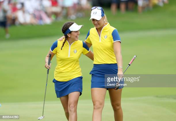 Georgia Hall of England and Anna Nordqvist of Sweden and the European Team celebrate on the 16th hole after Hall had holed a crucial putt in their...