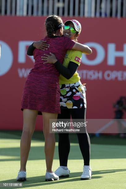 Georgia Hall of England and Pornanong Phatlum of Thailand hug each other after finishing the final round during day four of Ricoh Women's British...