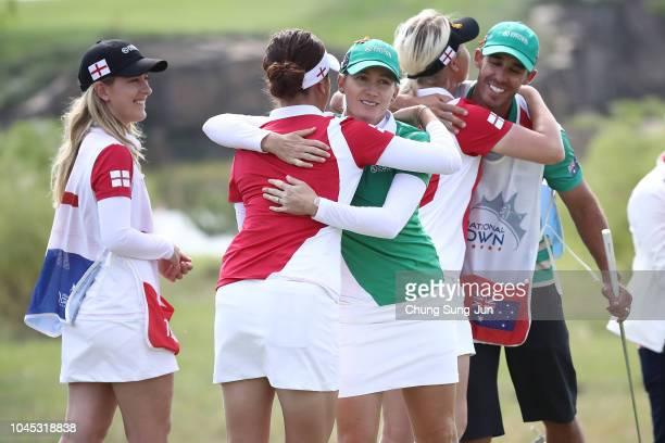 Georgia Hall of England and Sarah Jane Smith of Australia embrace after the Pool A match between England and Australia on day one of the UL...