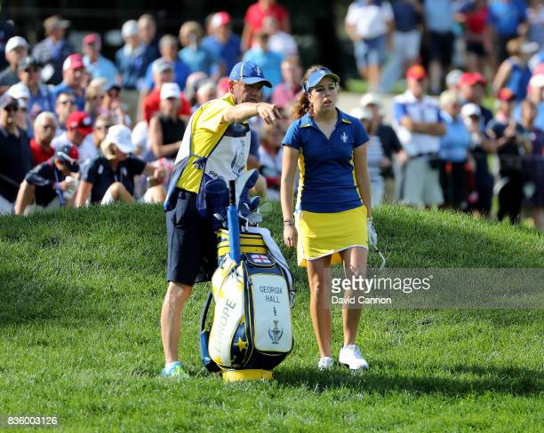 Georgia Hall of England and the European team in action with her father Wayne Hall caddying against Paula Creamer of the United States team during...