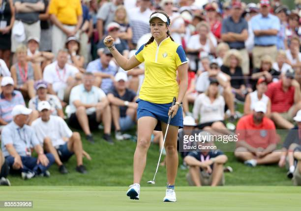 Georgia Hall of England celebrates holing the match winning putt in her match with Anna Nordqvist of Sweden against Stacy Lewis and Gerina Piller of...