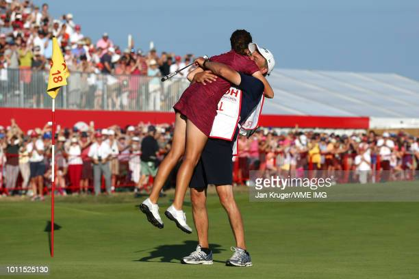 Georgia Hall of England celebrates with her father / caddie Wayne Hall on the 18th green during the final round of the Ricoh Women's British Open at...