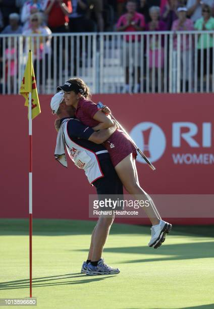 Georgia Hall of England celebrates with her father who caddied for her after finishing the final round and winning the tournament during day four of...