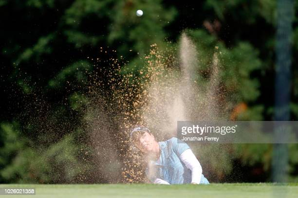 Georgia Hall of England hits out of the bunker on the 1st hole during the third round of the LPGA Cambia Portland Classic at Columbia Edgewater...