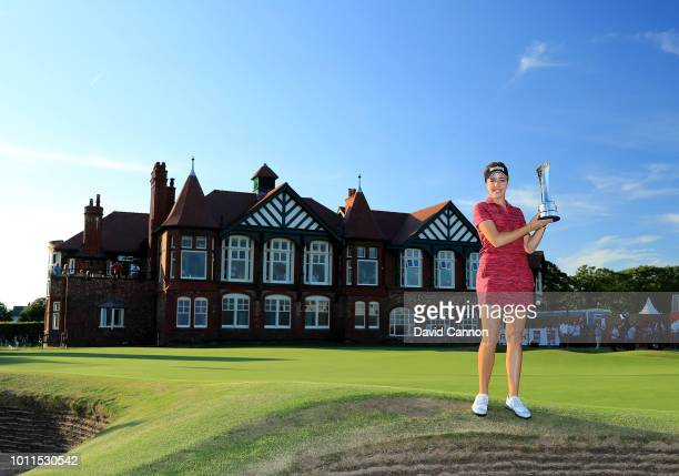 Georgia Hall of England holds the trophy after her victory in the final round of the Ricoh Women's British Open at Royal Lytham and St Annes Golf...