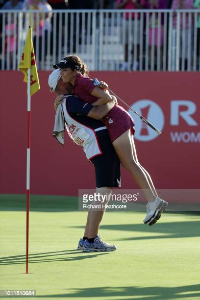 Georgia Hall of England hugs her caddy after finishing the final round and winning the tournament during day four of Ricoh Women's British Open at...