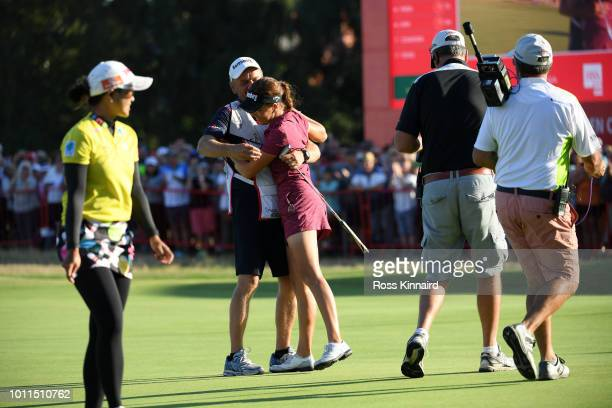 Georgia Hall of England hugs her caddy after finishing the final wound and winning the tournament during day four of Ricoh Women's British Open at...