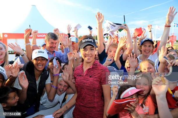 Georgia Hall of England is greeted by a large group of young children after her victory in the final round of the Ricoh Women's British Open at Royal...