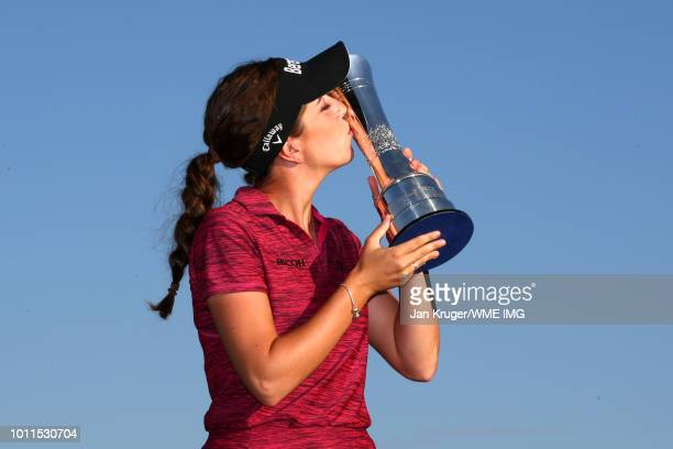 Georgia Hall of England kisses the trophy following her victory during the final round of the Ricoh Women's British Open at Royal Lytham St Annes on...