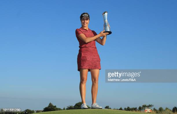 Georgia Hall of England pictured with the trophy after winning the Ricoh Women's British Open during day four of the Ricoh Women's British Open at...