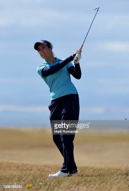 Georgia Hall of England plays her second shot at the 16th hole during the third day of the Aberdeen Ladies Scottish Open at Gullane Golf Course on...