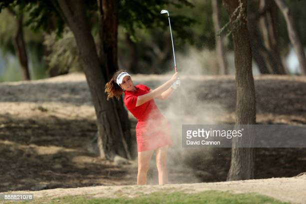 Georgia Hall of England plays her second shot on the par 13th hole during the final round of the 2017 Dubai Ladies Classic on the Majlis Course at...