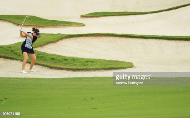 Georgia Hall of England plays her third shot from a bunker on the 13th hole during round two of the HSBC Women's World Championship at Sentosa Golf...
