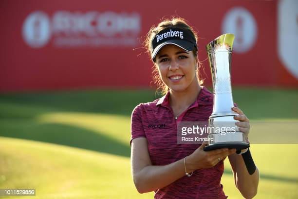 Georgia Hall of England poses for a photo with her trophy after winning the tournament during day four of Ricoh Women's British Open at Royal Lytham...
