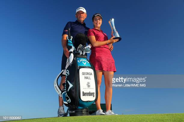 Georgia Hall of England poses with the trophy and father / caddie Wayne following her victory during the final round of the Ricoh Women's British...