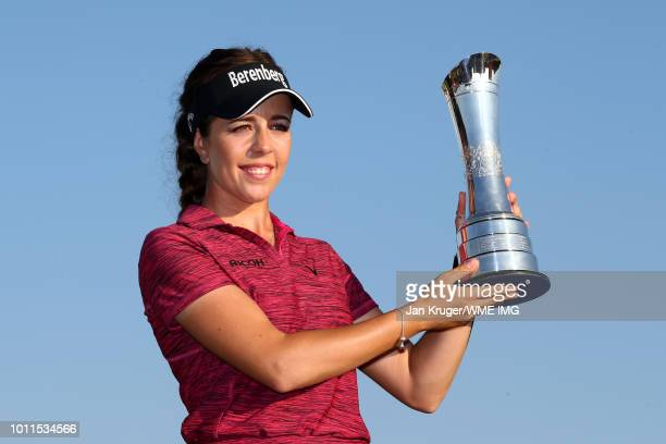 Georgia Hall of England poses with the trophy following her victory during the final round of the Ricoh Women's British Open at Royal Lytham St Annes...