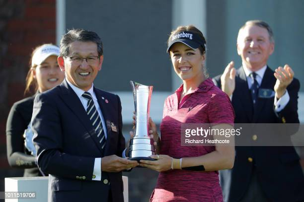 Georgia Hall of England receivs the trophy from Yoshinori Yamashita CEO of Ricoh after winning the tournament during day four of Ricoh Women's...