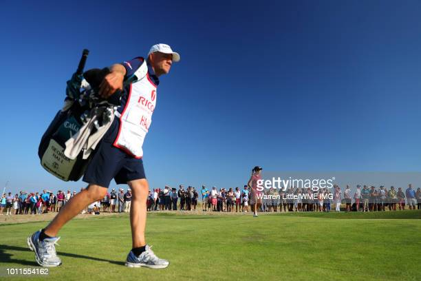 Georgia Hall of England walks with her father / caddie Wayne Hall on the 16th hole during the final round of the Ricoh Women's British Open at Royal...
