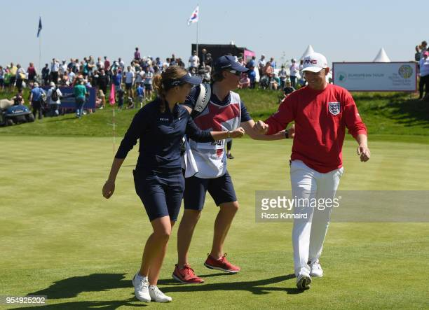 Georgia Hall of England Women and Matt Wallace of England celebrate on the sixth green during Day One of the GolfSixes at The Centurion Club on May 5...