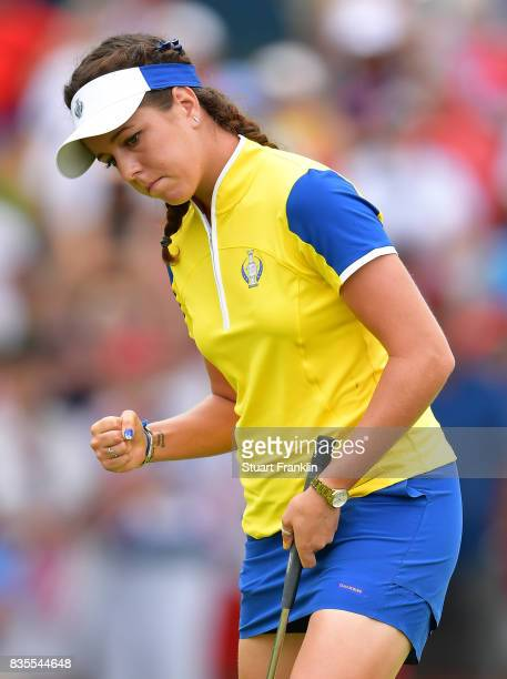 Georgia Hall of Team Europe celebrates holeing a putt during the second day morning foursomes matches of The Solheim Cup at Des Moines Golf and...