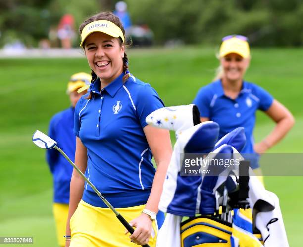 Georgia Hall of Team Europe laughs in reaction to her putt on the 18th green during practice for the Solheim Cup at the Des Moines Golf and Country...