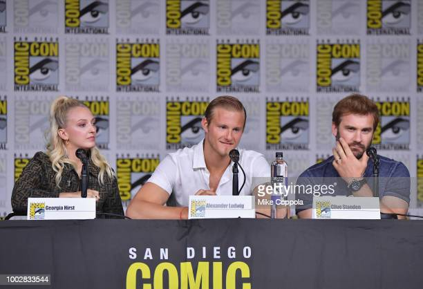 Georgia Hirst Alexander Ludwig and Clive Standen speak onstage at History's Vikings panel during ComicCon International 2018 at San Diego Convention...