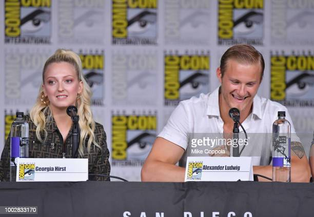 Georgia Hirst and Alexander Ludwig speak onstage at History's Vikings panel during ComicCon International 2018 at San Diego Convention Center on July...