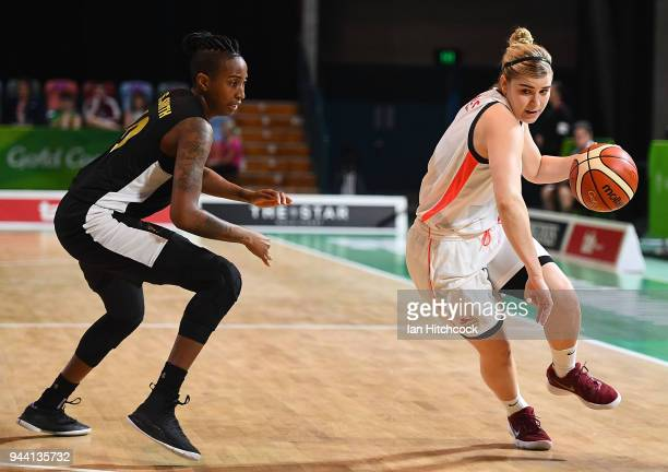 Georgia Jones of England attempts to get past Shenneika Smith of Jamaica during the womens Qualifying Final between England and Jamaica on day six of...