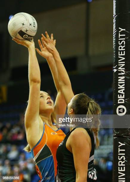 Georgia Marshall of the Giants shoots for goal during the Australian Netball League grand final between the Tasmanian Magpies and the Canberra Giants...