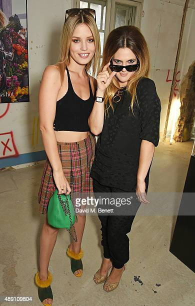 Georgia May Jagger and Drew Barrymore attend the Sunglass Hut London Fashion Week 'Punked Up' Afternoon Tea Party on September 19 2015 in London...