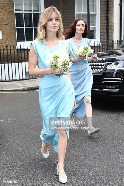 Georgia May Jagger and Elizabeth Jagger arrive at Spencer House for the Wedding Reception on March 5 2016 in London England