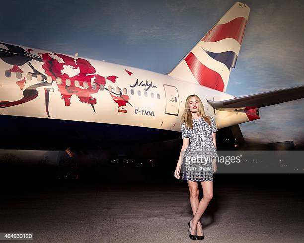 Georgia May Jagger dressed in a Masha Ma Spring/Summer 2015 outfit poses next to a British Airways 777 aircraft with a livery design created by...