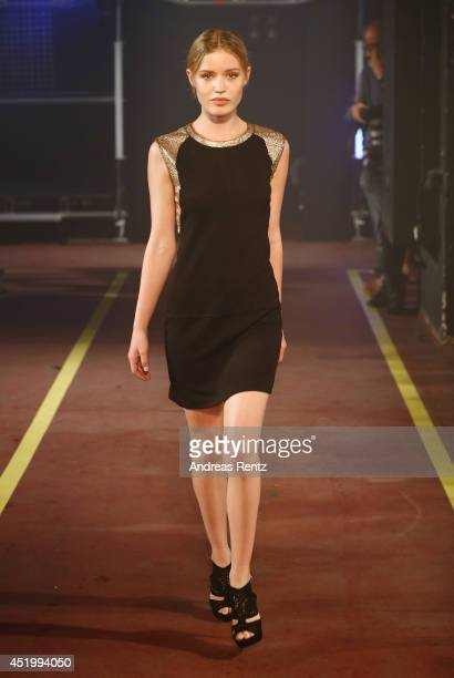 Georgia May Jagger walks down the catwalk during the Reserved Let's Fashion Party at the MercedesBenz Fashion Week Spring/Summer 2015 at Alte Muenze...