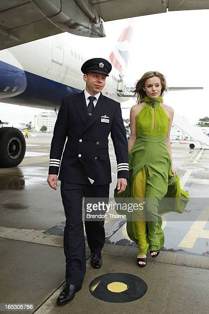 Georgia May Jagger wearing Tech Empire dress by PPQ poses is escorted by a British Airways pilot on April 3 2013 in Sydney Australia Celebrating a...