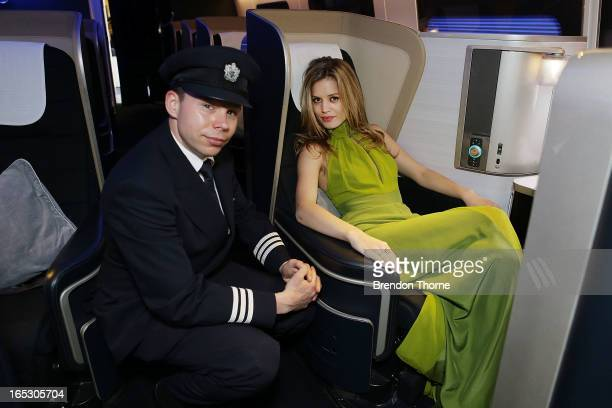 Georgia May Jagger wearing Tech Empire dress by PPQ poses with a British Airways pilot in first class on April 3 2013 in Sydney Australia Celebrating...
