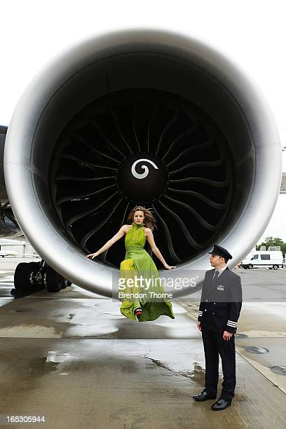 Georgia May Jagger wearing Tech Empire dress by PPQ poses with a British Airways pilot inside an engine of a British Airways 777 airlcraft on April 3...