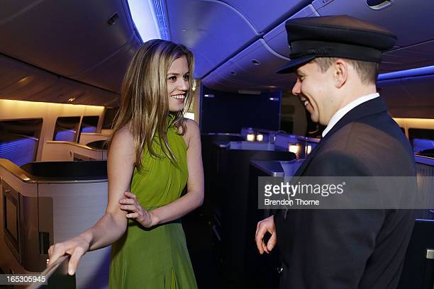 Georgia May Jagger wearing Tech Empire dress by PPQ speaks with a British Airways pilot in first class on April 3 2013 in Sydney Australia...
