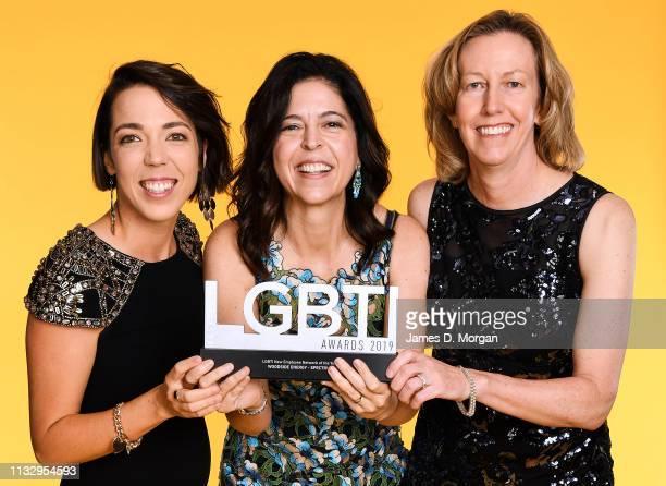 Georgia McClanachan Kimberly Walpot and Meg O'Neill pose with the New LGBTI Employee Network of the Year award at the 2019 Australian LGBTI Awards at...