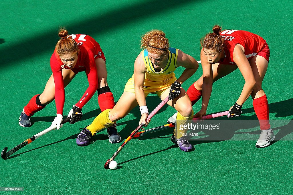 Georgia Nanscawen of Australia is challenged by Oh Sunsoon and Kim Young Ran of Korea during the International Test match between the Australian Hockeyroos and Korea at Perth Hockey Stadium on April 27, 2013 in Perth, Australia.