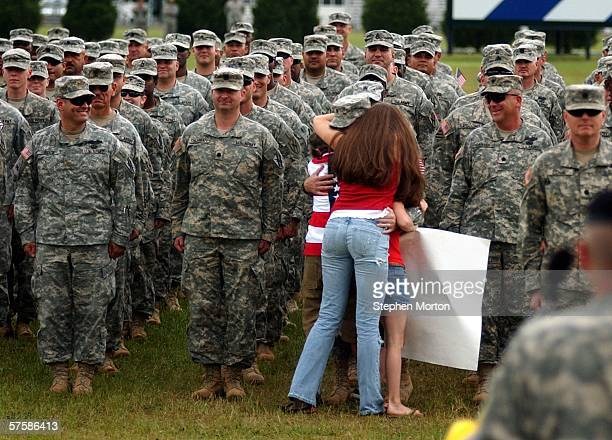 Georgia National Guardsman Lt. Col. George Fisher of Macon, Georgia hugs his daughter Amanda , son Joe and youngest daughter, Lyndsay , prior to...