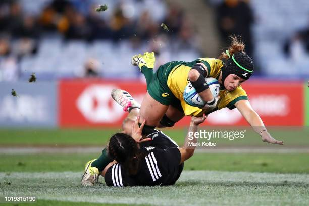 Georgia ONeill of the Wallaroos is tackled by Theresa Fitzpatrick of the Black Ferns during the Women's Rugby International match between the...