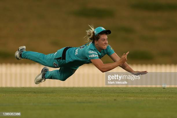 Georgia Prestwidge of the Heat attempts a diving runout during the Women's Big Bash League WBBL match between the Brisbane Heat and the Sydney...
