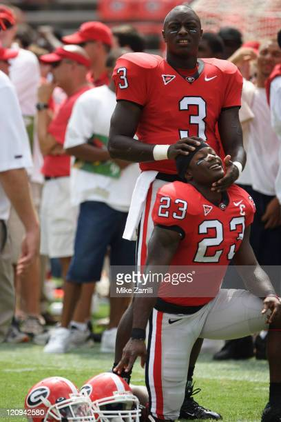 Georgia QB D.J. Shockley stretches Tim Jennings before the game against Louisiana Monroe at Sanford Stadium in Athens, GA on September 17, 2005. The...