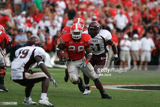 Georgia RB Danny Ware breaks through the line against Louisiana Monroe at Sanford Stadium in Athens GA on September 17 2005 The Bulldogs beat the...