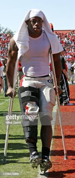 Georgia RB Thomas Brown walks off of the field on crutches after tearing his ACL during the game between the Georgia Bulldogs and the Vanderbilt...