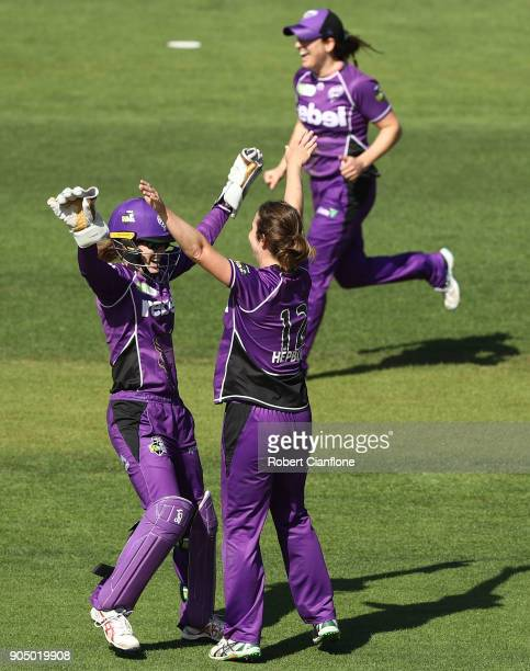 Georgia Redmayne and Brooke Hepburn of the Hurricanes celebrate the wicket of Emma Inglis of the Renegades during the Women's Big Bash League match...