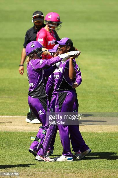 Georgia Redmayne and Hayley Matthews of the Hurricanes celebrate the run out Sarah Aley of the Sixers during the Women's Big Bash League match...