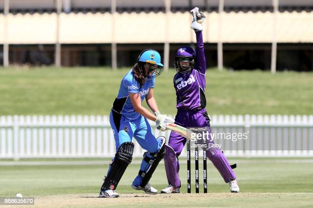 Georgia Redmayne of the Hobart Hurricanes appeals for the wicket of Tahlia McGrath of the Adelaide Strikers during the Women's Big Bash League WBBL...